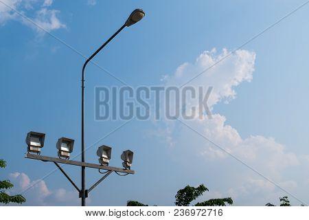 Pillar Spotlights On Blue Sky Background.