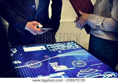 Hand holding using smartphone in a technology meeting