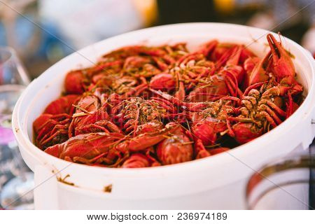 Crayfishes Boiled Red In A Bucket Of White At A Party