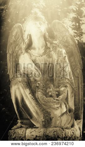 Figure Of Angel As A Symbol Of Love, Kindness, And Suffering. Ancient Statue. Retro Styled.