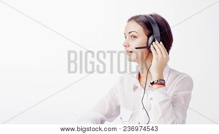 Portrait Of Cheerful Support Phone Operator In Headset On White Background