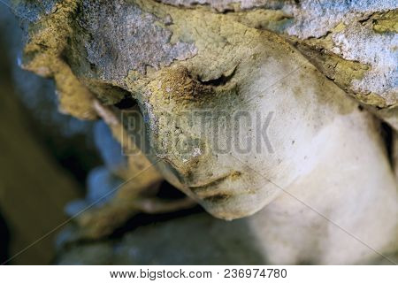 Close Up Of Sad Guardian Angel. (fragment Of An Ancient Statue)