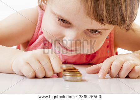 Teaching Kid Business. Start Financial Education Of Cute Little Child Girl With Coins. Wealth, Money
