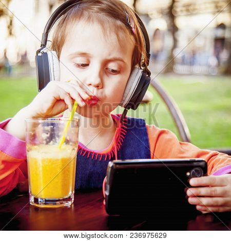 Concept Of Gambling Addiction And Negative Impact On Children. The Little Child Girl Gamer Playing M