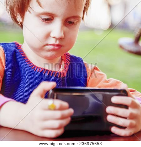 Social Media Addiction. Little Child Girl Holding Smart Phone (psychological Problems, Media Mania,
