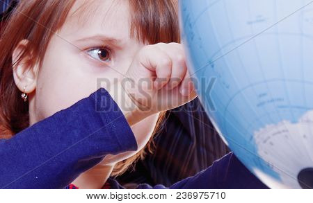 Knowledge And Science Concept. Cute Child Girl Looking At The Globe And Teaching Geography.