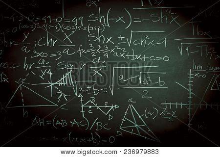 math formula on slate blackboard background
