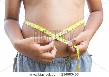 Close Up Hands Boy Measuring Tape On Abdominal Surface , Fat And  Health Care Concept.