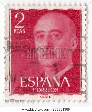 Leeds, England - April 20 2018: An Old Red Postage Stamp Spanish With An Image Of General Franco