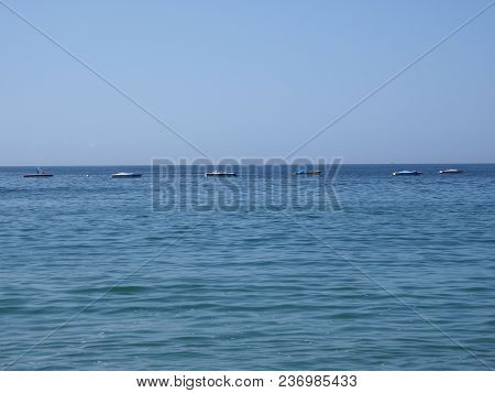 Panoramic View Of Water At Bay Of Acapulco City In Mexico And Waves Of Pacific Ocean With Clear Blue