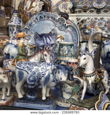 Amsterdam, Holland - 14 April 2018 White-blue Porcelain Figurines Of Animals In Traditional Dutch St