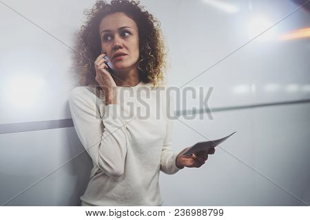 Charming Young Woman On Transit Talking On Smartphone While Holding With Hand Travel Ticket In Train