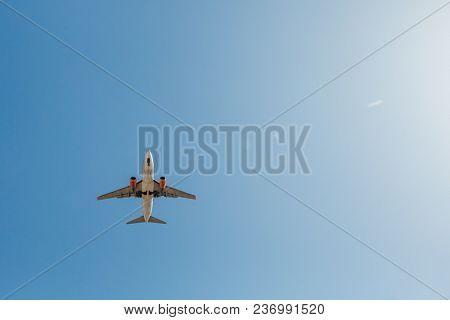 flying airplane in blue sky