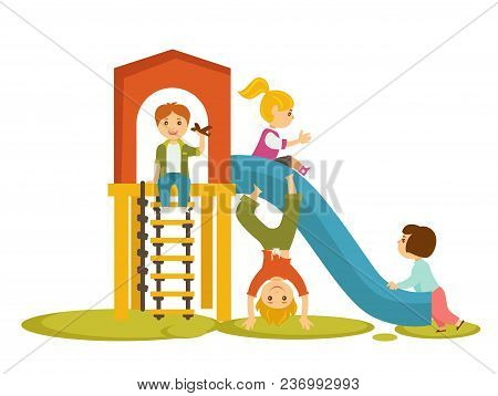 Kids Or Children Playing On Playground In Kindergarten. Boy With Toy Plane Play With Girls Riding On