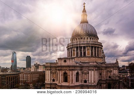 famous St. Pauls Cathedral with dramatic sky and evening sun in London, Great Britain