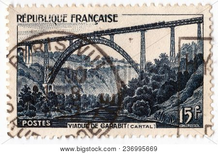Leeds, England - April 20 2018: An Old Blue French Postage Stamp With An Image Of Garabit Viaduct Ra