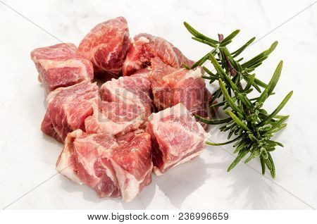 Cube Pork Neck With Rosemary On White Background