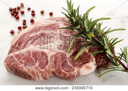 Pork Neck With Rosemary And Red Peppercorn On Marble