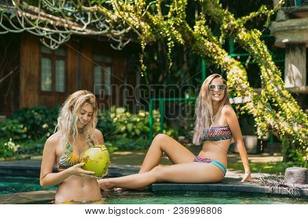 Beautiful Happy Young Women In Bikini Relaxing Together At Swimming Pool