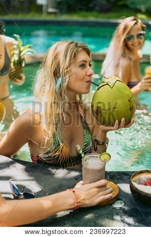 Beautiful Smiling Young Woman In Bikini Drinking Cocktail From Fresh Coconut White Relaxing In Swimm