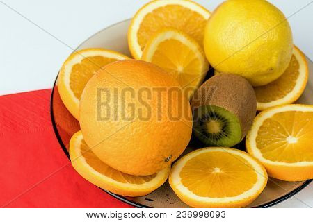Fruits On Plate On White Background. Sliced Straight.