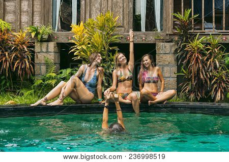 Happy Young Women In Swimwear Having Fun Near Swimming Pool
