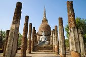 On the ruins of ancient Buddhist temple. Sukhothai, Thailand poster