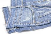 detail of a front pocket in a blue jeans pants poster