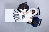 Business people at meeting, view from above. Bookkeeper or financial inspector  making report, calculating or checking balance. Internal Revenue Service checking financial document. Audit and tax concept poster