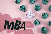 Handwriting text Mba. Concept meaning Master of Business Administration Advance Degree After College Studies written Painted Pink background Crumpled Paper Balls next to it. poster
