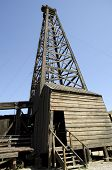 Old fashioned 1920s wooden oil derrick from the California oil fields poster