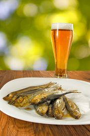 Beer And A Fish On A Green Background Close-up