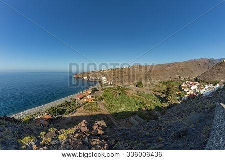 Early Morning Of Quiet Warm, Sunny Weather In The Beach And Harbor. Aerial View Of Playa De Santiago