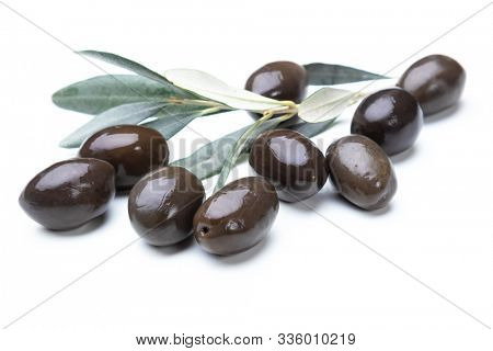 Black pickled olives isolated on white background