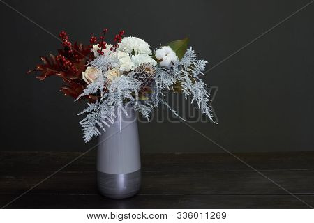 Christmas And New Year Composition Bouquet In A Ceramic Vase On A Dark Background, Selective Focus