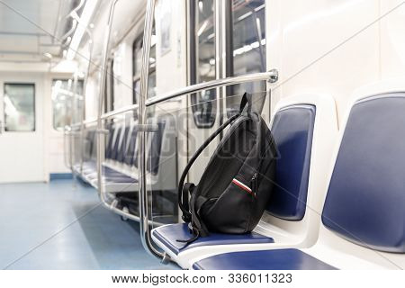 Forgotten Leather Black Backpack/bag Or Bomb To Commit A Terrorist Attack Lies On A Seat In Subway T