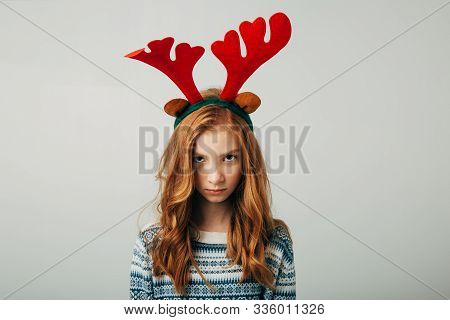 The Red-haired Girl Was Very Offended By Her Parents On Christmas Evening. Blue-eyed Cutie Angry At