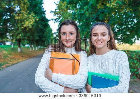 Two Teenage Girls Teenagers, Best Girlfriends, Summer City Park, Holding Notebooks Notes, Emotions O