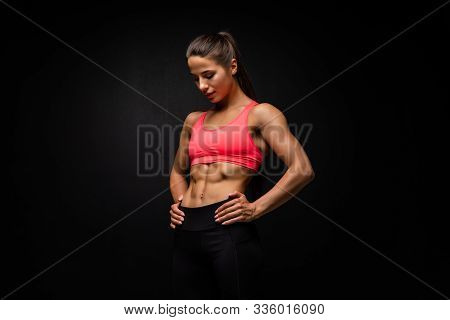 Young Fitness Young Woman On Black Background