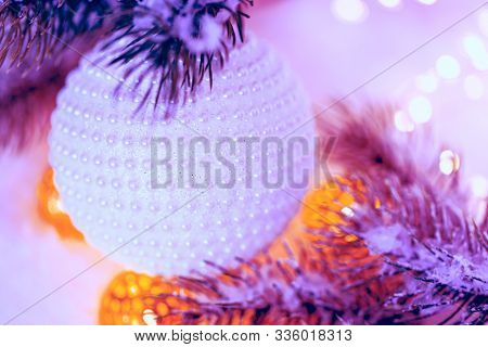 Christmas And New Year Holiday Greeting Card. Beautiful Ball With Nacre Pearls, Pine Branches And A