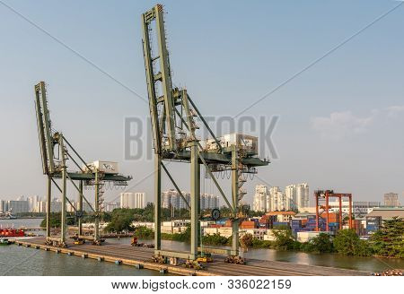 Ho Chi Minh City, Vietnam - March 13, 2019: Vict Port On Song Sai Gon River At Sunset. 2 Idle Green