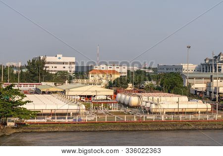Ho Chi Minh City, Vietnam - March 13, 2019: Totalgaz Port On Song Sai Gon River At Sunset. Rows Of W