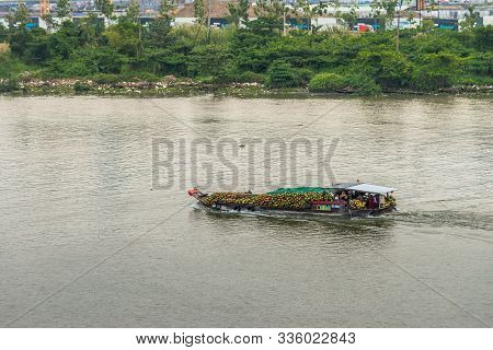 Ho Chi Minh City, Vietnam - March 13, 2019: Closeup Of Barge Full Of Freshly Harvested Green And Bro