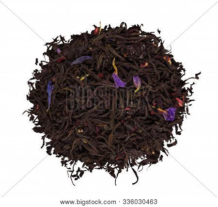 A Pile Of Dried Barberry Tea Leaves Isolated On White. Clipping Path Included.