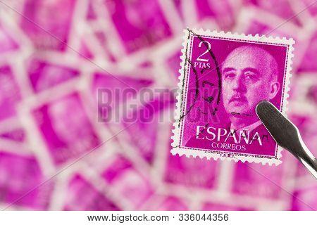 Seattle Washington -november 22, 2019: Hot Pink Spanish Postage Stamp With Dictator Franco. Scott #