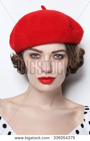 Vintage style portrait of young beautiful woman with red lips