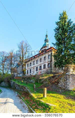 Old Deanery And St George Church In Horni Slavkov. Sunny Autumn Day. Czech Republic
