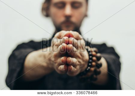 Fingers Pointing Forward To The Camera. Hands Folded In Prayer. Close-up Of Palm Together. The Beads