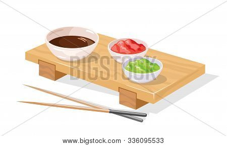 Wooden Sushi Geta Tray Served With Pickled Ginger, Wasabi, Soy Sauce In Bowls And Chopsticks Awaitin