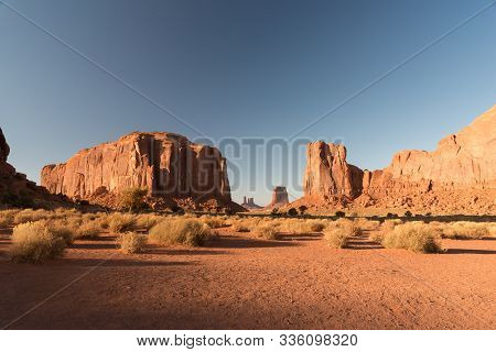 A Sunset View Of The Arid Lands In Monument Valley With The Mesas At The Back